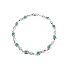 9ct White Gold Diamond Oval Emerald Bracelet