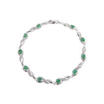 9ct White Gold Diamond Oval Emerald Bracelet